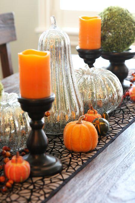"""<p>Shiny mercury glass pumpkins paired with black-and-orange decor is a match made in Halloween heaven. </p><p><strong>Get the tutorial at <a href=""""https://ourbestbites.com/tips-for-spooktacular-fall-decor/"""" rel=""""nofollow noopener"""" target=""""_blank"""" data-ylk=""""slk:Our Best Bites"""" class=""""link rapid-noclick-resp"""">Our Best Bites</a>.</strong> </p>"""