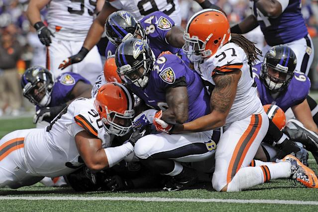 Baltimore Ravens running back Bernard Pierce powers his way into the end zone for a touchdown as Cleveland Browns defensive end Billy Winn (90) and outside linebacker Jabaal Sheard (97) try to stop him during the second half of an NFL football game in Baltimore, Md., Sunday, Sept. 15, 2013. (AP Photo/Nick Wass)