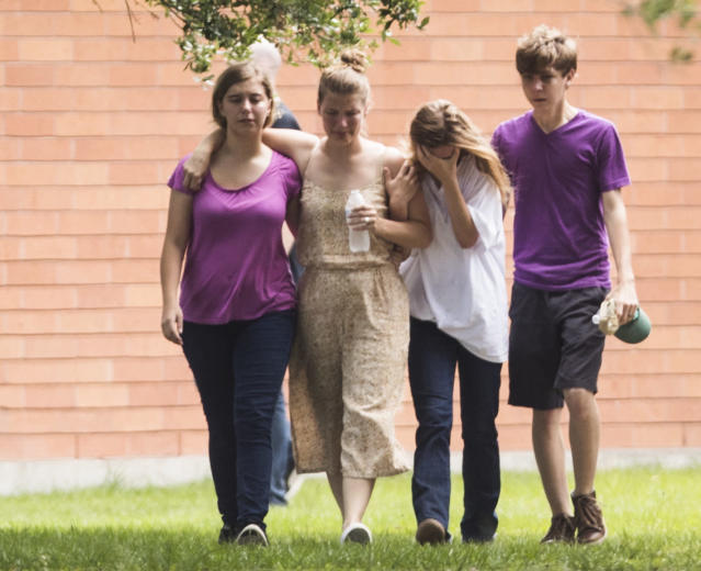 <p>Students are emotional as they gather by the Barnett Intermediate School where parents are gathering to pick up their children following a shooting at Santa Fe High School on Friday, May 18, 2018, in Santa Fe, Texas. (Photo: Marie D. De Jesus/Houston Chronicle via AP) </p>