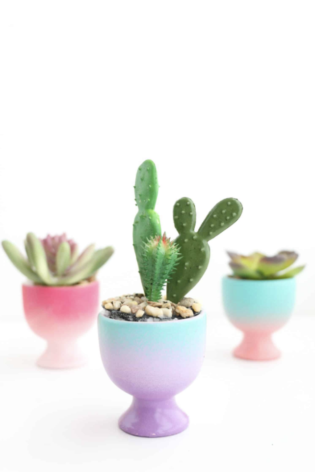 """<p>For decor that doesn't scream Easter but is still just as fitting, try these painterly egg cups. </p><p><a class=""""body-btn-link"""" href=""""https://abeautifulmess.com/2018/03/diy-mini-gradient-egg-cup-planters.html"""" target=""""_blank"""">GET THE TUTORIAL</a></p><p><a class=""""body-btn-link"""" href=""""https://www.amazon.com/HIC-Harold-Co-400220-Porcelain/dp/B00S4RDPOO/ref=sr_1_6?keywords=egg+cups&qid=1583767169&sr=8-6&tag=syn-yahoo-20&ascsubtag=%5Bartid%7C10072.g.31280852%5Bsrc%7Cyahoo-us"""" target=""""_blank"""">SHOP EGG CUPS</a></p>"""