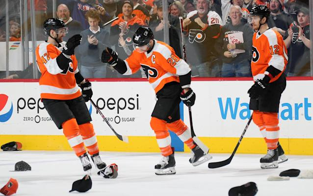 "It rained hats on <a class=""link rapid-noclick-resp"" href=""/nhl/players/4002/"" data-ylk=""slk:Claude Giroux"">Claude Giroux</a> as the Flyers and their captain punched their postseason ticket with a drubbing of the Rangers on Saturday. (Getty)"