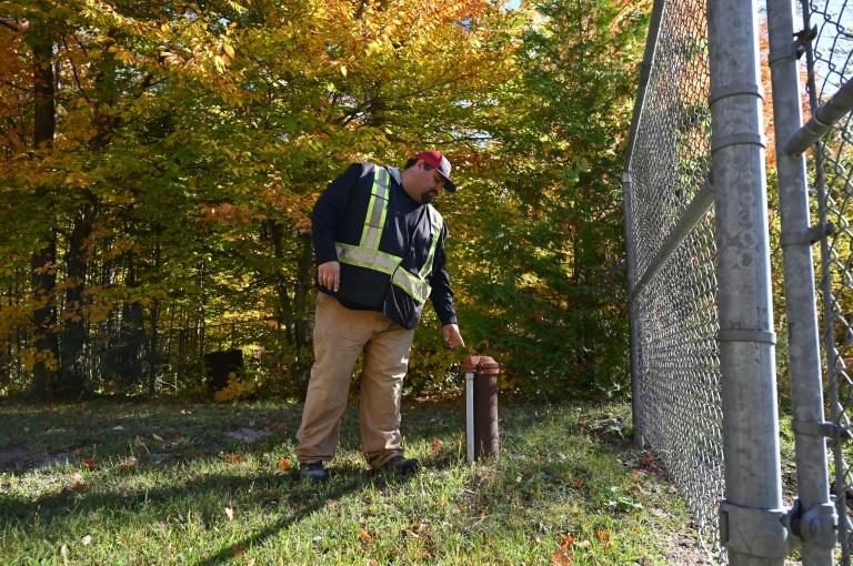 Curve Lake First Nation official Richard Taylor shows a well outside a water treatment facility in Curve Lake, Canada