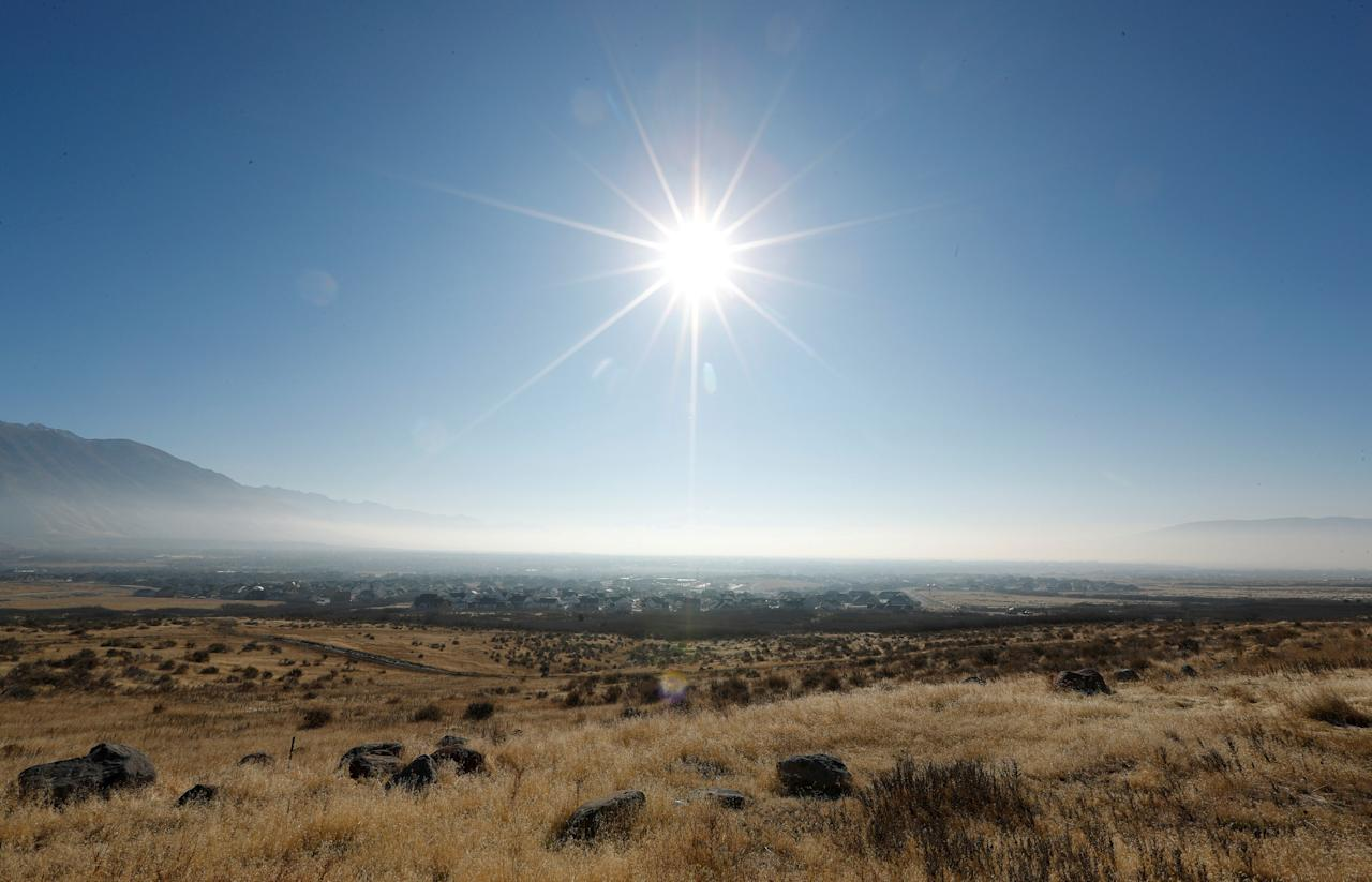 The sun shines above thick smog trapped in Utah Valley in Alpine, Utah, U.S. December 12, 2017. Sometimes during the winter, temperature inversions form in Salt Lake Valley, when the upper air temperature is warmer than the air on the valley floor, forming a lid, trapping polluted air. REUTERS/George Frey     TPX IMAGES OF THE DAY