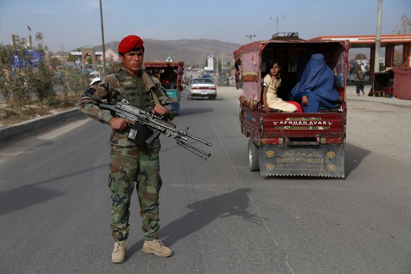 An Afghan security personnel keep watch at a checkpoint in Ghazni on October 29, 2018