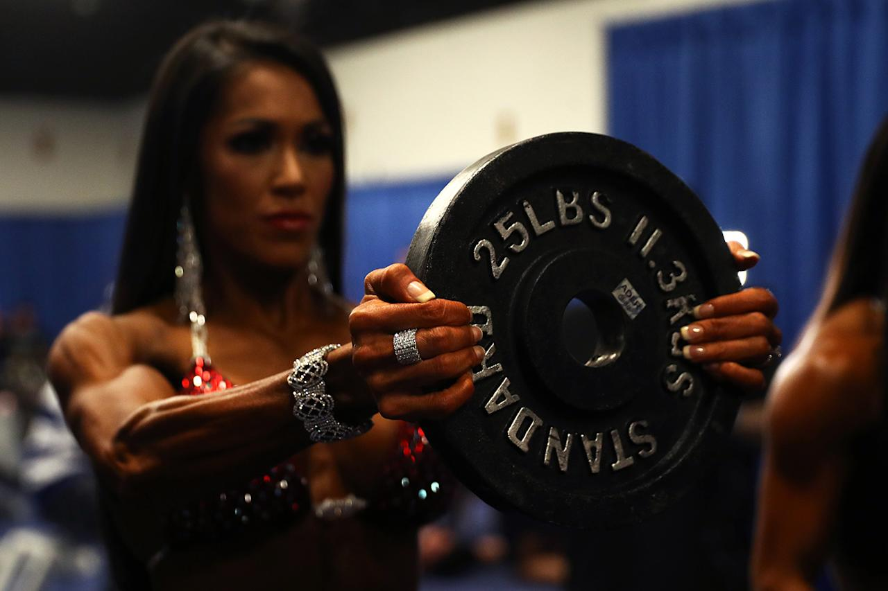 <p>A Bikini International contestant warms up before taking the stage at the Greater Columbus Convention Center during the Arnold Sports Festival 2017 on March 4, 2017 in Columbus, Ohio. (Photo: Maddie Meyer/Getty Images) </p>