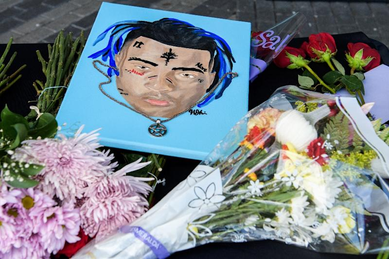 XXXTentacion was shot in what investigators are treating as  a robbery attempt, and fans left items at a makeshift memorial for the rapper in Sunrise, Florida