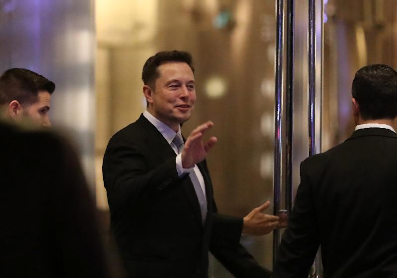 Elon Musk, founder and chief executive of electric carmaker Tesla, seen at a ceremony in Dubai in February, said he would quite President Donald Trump's advisory panels if Washington pulls out of the Paris global climate agreement (AFP Photo/KARIM SAHIB)