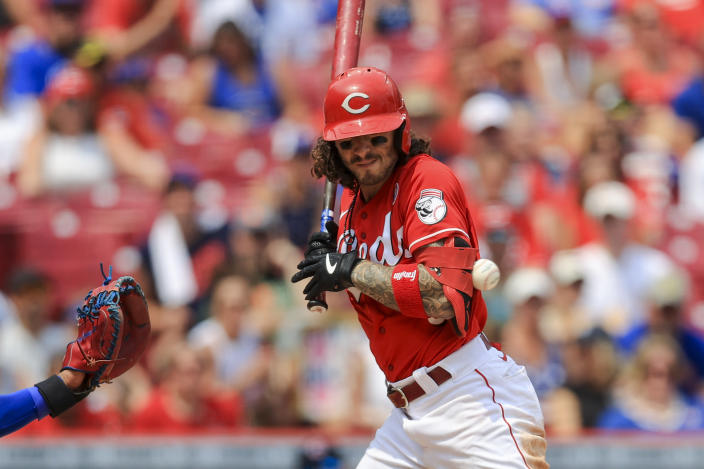 Cincinnati Reds' Jonathan India reacts as he is hit by a pitch with the bases loaded during the seventh inning of a baseball game against the Chicago Cubs in Cincinnati, Sunday, July 4, 2021. Cincinnati Reds' Kyle Farmer scored on the play. (AP Photo/Aaron Doster)