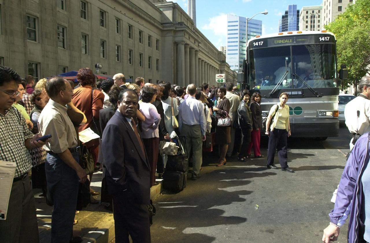 <p>An overwhelming crowd of commuters in front of Union Station in Toronto is seen trying to catch a GO bus home around noon on Tuesday after the terrorist attacks in the U.S. on Sept. 11, 2001. (Photo by Louie Palu/The Globe And Mail) </p>