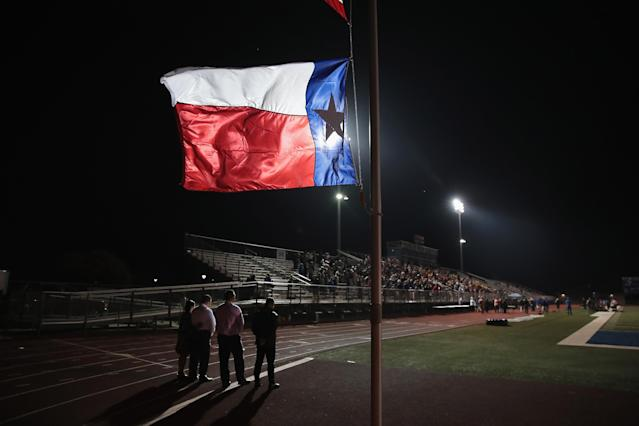 <p>A Texas flag flies at half mast during a prayer services at the La Vernia High School Football stadium to grieve the 26 victims killed at the First Baptist Church of Sutherland Springs on Nov. 7, 2017 in La Vernia, Texas. (Photo: Scott Olson/Getty Images) </p>