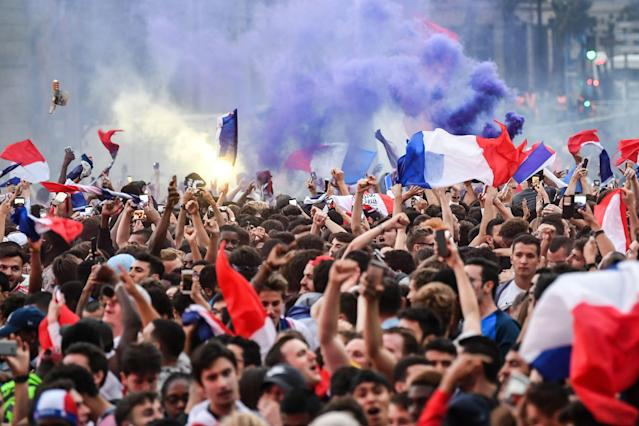 <p>People celebrate France's victory at a fan zone in central Paris on July 10, 2018 at the final whistle of the Russia 2018 World Cup semi-final football match between France and Belgium. (Photo by Eric FEFERBERG / AFP) </p>