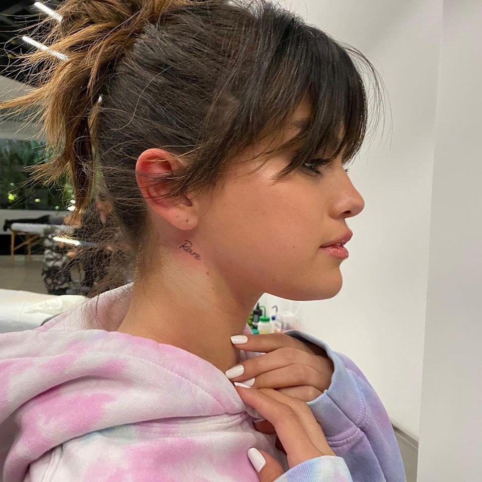 """<p>In honor of <a href=""""https://www.seventeen.com/celebrity/celebrity-couples/a30469508/selena-gomez-new-album-rare-justin-bieber-lyrics/"""" rel=""""nofollow noopener"""" target=""""_blank"""" data-ylk=""""slk:her new album"""" class=""""link rapid-noclick-resp"""">her new album</a>, Selena Gomez got """"Rare"""" tattooed on her neck right below her ear. The font matches that of the title cover exactly, making for a super elegant tat. """"Did it again @bangbangnyc 🦋 rare,"""" Sel captioned the <a href=""""https://www.instagram.com/p/B7X6rQkjA9B/"""" rel=""""nofollow noopener"""" target=""""_blank"""" data-ylk=""""slk:Instagram"""" class=""""link rapid-noclick-resp"""">Instagram</a> showing off her new ink. </p>"""