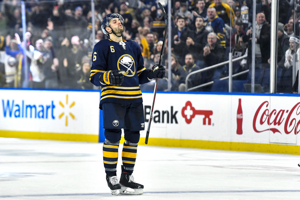 Buffalo Sabres defenseman Marco Scandella celebrates his goal against the Los Angeles Kings during the second period of an NHL hockey game in Buffalo, N.Y., Saturday, Dec. 21, 2019. (AP Photo/Adrian Kraus)