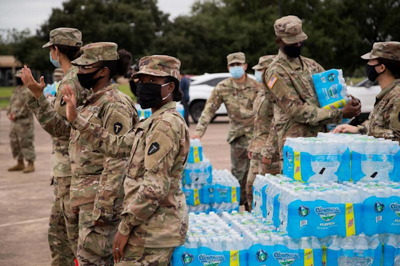 National Guard soldiers distribute bottled water to residents of Jackson: AP