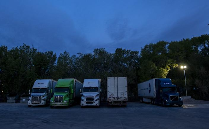 """Truckers park for the night at the Sinclair gas station in Alamo, Nev. <span class=""""copyright"""">(Brian van der Brug / Los Angeles Times)</span>"""