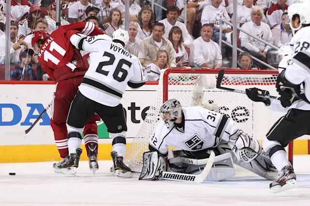 GLENDALE, AZ - MAY 15: Goaltender Jonathan Quick #32 of the Los Angeles Kings defends his net as teammate Slave Voynov #26 defends Martin Hanzal #11 of the Phoenix Coyotes in the second period of Game Two of the Western Conference Final during the 2012 NHL Stanley Cup Playoffs at Jobing.com Arena on May 15, 2012 in Phoenix, Arizona. (Photo by Christian Petersen/Getty Images)