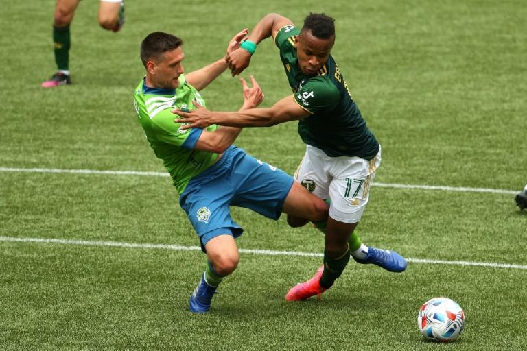 Seattle's Shane O'Neill and Portland's Jeremy Ebobisse battle for possession in the second half of the Sounders' 2-1 MLS win over the Timbers