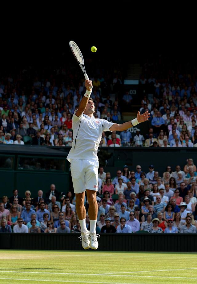 Serbia's Novak Djokovic in action against Argentina's Juan Martin Del Potro during day eleven of the Wimbledon Championships at The All England Lawn Tennis and Croquet Club, Wimbledon.