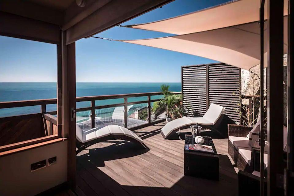 """<p>It looks like a heavenly view from a beach house but this unique rental is more like a luxury treehouse nestled high into the cliffside. The cedar cabin overlooks the beach in Ventnor and has bi-fold windows along two sides that open up your room, so it's just you, the sea and the horizon. </p><p>The space for two is mostly made of an open-plan room with a king-sized bed overlooking the sea, with a Nespresso machine, fluffy robes and the large balcony with sun loungers to complete the hotel-style experience.</p><p><strong>Sleeps:</strong> 2</p><p><strong>Available from:</strong> <a href=""""https://airbnb.pvxt.net/mgn6de"""" rel=""""nofollow noopener"""" target=""""_blank"""" data-ylk=""""slk:Airbnb"""" class=""""link rapid-noclick-resp"""">Airbnb</a></p><p><strong>Price: </strong>One night from £241</p><p><a class=""""link rapid-noclick-resp"""" href=""""https://airbnb.pvxt.net/mgn6de"""" rel=""""nofollow noopener"""" target=""""_blank"""" data-ylk=""""slk:CHECK AVAILABILITY"""">CHECK AVAILABILITY</a></p>"""