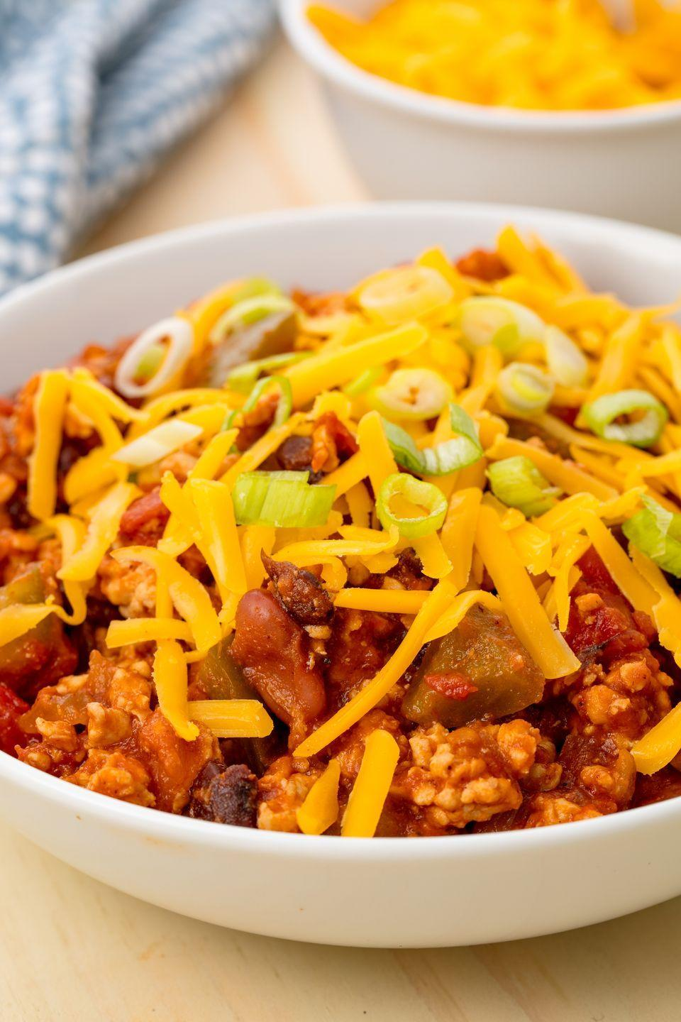 """<p>Warm up after the tailgate with some turkey chili. </p><p>Get the recipe from <a href=""""https://www.delish.com/cooking/recipe-ideas/recipes/a55200/easy-turkey-slow-cooker-chili-recipe/"""" rel=""""nofollow noopener"""" target=""""_blank"""" data-ylk=""""slk:Delish"""" class=""""link rapid-noclick-resp"""">Delish</a>.</p>"""