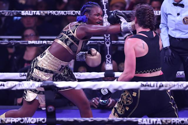 Claressa Shields (L) connects with a right on Ivana Habazin en route to winning the WBC super welterweight championship, making her the fastest fighter to win three weigh-class titles as a pro. (Edward Diller/Getty Images)