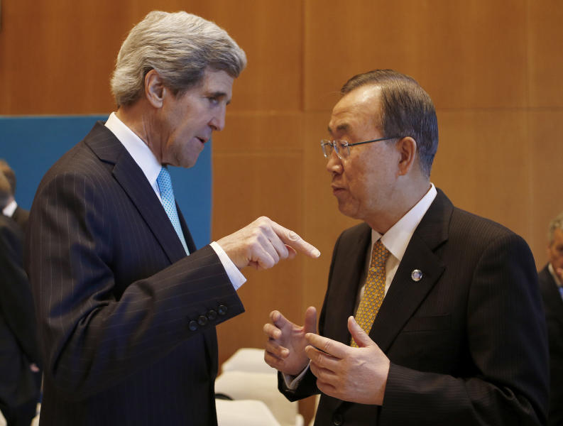 U.S. Secretary of State John Kerry, left, talks to U.N. Secretary-General Ban Ki-moon prior to the Syrian peace talks in Montreux, Switzerland, Wednesday, Jan. 22, 2014. Ban made a rare effort at solo diplomacy this week when he invited Iran to join this week's Syria peace talks, but it backfired, raising questions about the effectiveness of a U.N. secretary-general better known _ and often criticized _ for his reserved and scripted style. (AP Photo/Arnd Wiegmann, Pool)