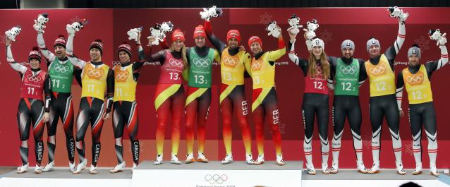 Luge - Pyeongchang 2018 Winter Olympic Games - Team Relay - Pyeongchang, South Korea - February 15, 2018 - Gold medalists Natalie Geisenberger, Johannes Ludwig, Tobias Wendl and Tobias Arlt of Germany, silver medalists Alex Gough, Sam Edney, Tristan Walker and Justin Snith of Canada, bronze medalists Madeleine Egle, David Gleirscher, Peter Penz and Georg Fischler of Austria celebrate during the victory ceremony. REUTERS/Arnd Wiegmann