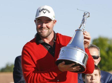 Mar 19, 2017; Orlando, FL, USA; Marc Leishman holds the champions trophy and wears the red memorial sweater after winning the Arnold Palmer Invitational golf tournament at Bay Hill Club & Lodge . Mandatory Credit: Reinhold Matay-USA TODAY Sports