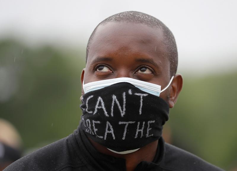 A man demonstrating in Hyde Park on Wednesday (Photo: ASSOCIATED PRESS)