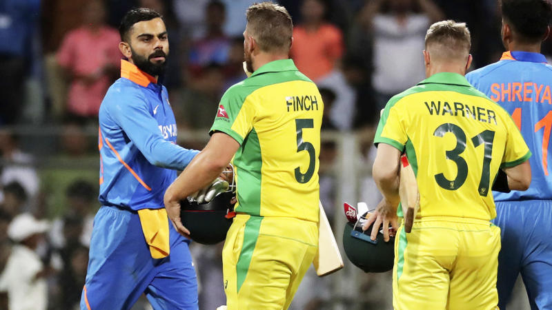 Virat Kohli, pictured here congratulating the Aussies after the first ODI on Tuesday in India.