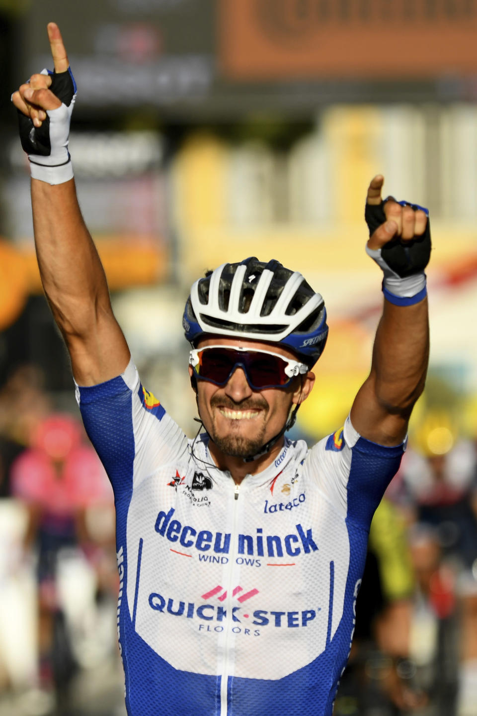 France's Julian Alaphilippe crosses the finish line to win the second stage of the Tour de France cycling race over 186 kilometers (115,6 miles) with start and finish in Nice, southern France, Sunday, Aug. 30, 2020. (Stuart Franklin/Pool photo via AP)