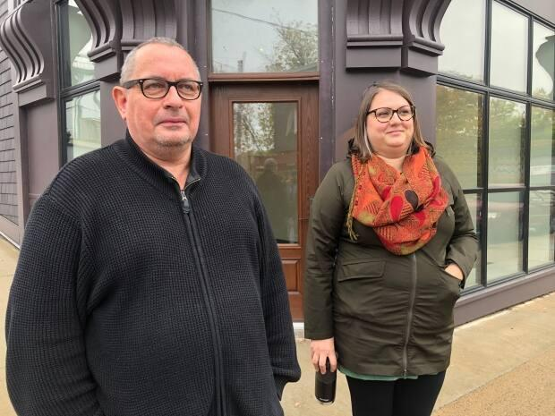 Art Fisher (left) and Lisa Ryan of the Family Services Association of Western Nova Scotia stand in front of the affordable housing resource centre in downtown Bridgewater in November 2020, formerly the Rofihe's store.