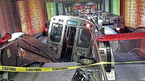 A Chicago Transit Authority train car rests on an escalator at the O'Hare Airport station after it derailed early Monday, March 24, 2014, in Chicago. AP Photo/NBC Chicago, Kenneth Webster