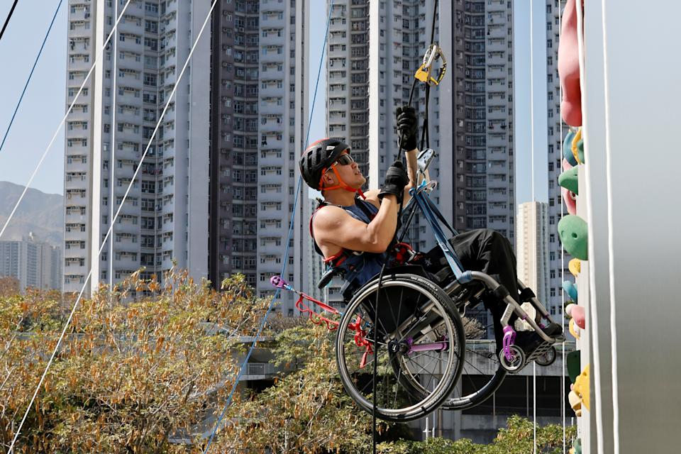Lai Chi-wai, a paraplegic climber, attends a training session, ahead of his attempt to climb the 320-metre tall Nina Tower using only his upper body strength, in Hong Kong, China December 29, 2020. Picture taken December 29, 2020. REUTERS/Tyrone Siu