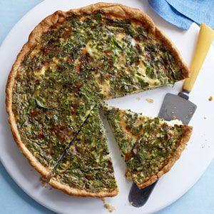 """<p>Prepare this cheesy quiche up to two days in advance (tossing in diced ham if you like) and have it do double duty: as part of Sunday brunch, then paired with a side salad for dinner the next day.</p><p><strong><a href=""""https://www.countryliving.com/food-drinks/recipes/a32710/spinach-herb-quiche-recipe-122774/"""" rel=""""nofollow noopener"""" target=""""_blank"""" data-ylk=""""slk:Get the recipe"""" class=""""link rapid-noclick-resp"""">Get the recipe</a>.</strong></p>"""