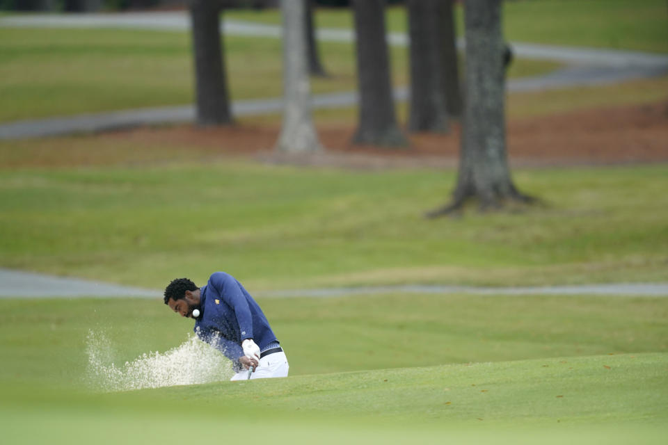 North Carolina A&T's J.R. Smith hits from a bunker on the 17th hole during the first round of the Phoenix Invitational golf tournament in Burlington, N.C., Monday, Oct. 11, 2021. Smith, who spent 16 years in the NBA made his college golfing debut in the tournament hosted by Elon. (AP Photo/Gerry Broome)