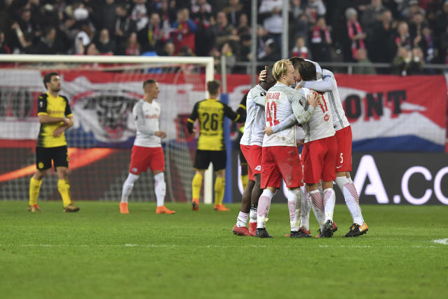 Salzburg's players celebrate after the Europa League - round of 16 second leg soccer match between FC Salzburg and Borussia Dortmund in the Arena in Salzburg, Austria, on Thursday, March 15, 2018. The match finished 0-0. (AP Photo/Kerstin Joensson)