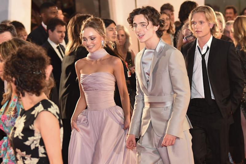 "Lily-Rose Depp and Timothée Chalamet attend ""The King"" red carpet."