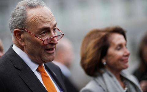 Chuck Schumer and Nancy Pelosi speak to the media as they depart after the meeting at the White House - Credit: CARLOS BARRIA/REUTERS