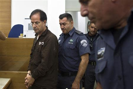 Iranian-Belgian citizen Mansouri arrives at a courtroom at the magistrate's court in Petah Tikva