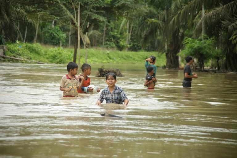 Authorities warned residents to stay vigilant because heavy rains in the area will continue (AFP/Azwar Ipank)