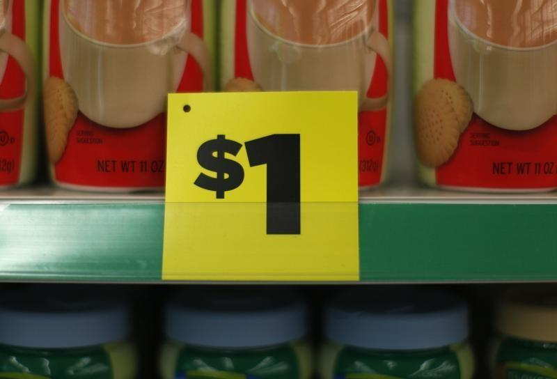 A price sign is displayed at a Dollar General store in Arvada