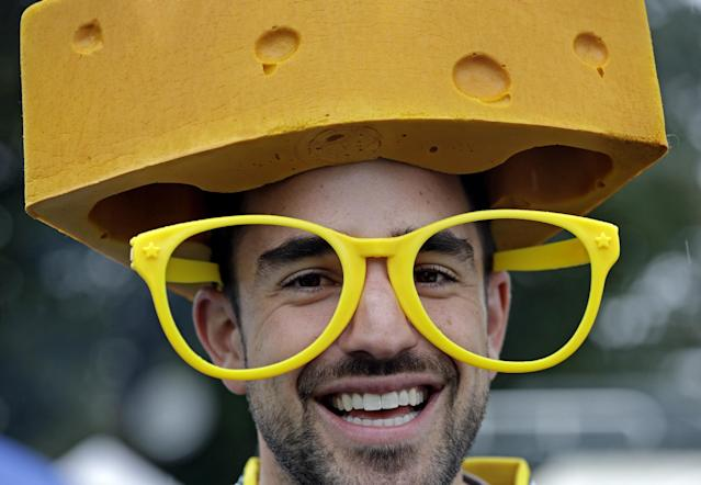 Brian Falasca of Washington, DC., wears a cheesehead and glasses outside Lambeau Field before an NFL football game between the Green Bay Packers and the Washington Redskins Sunday, Sept. 15, 2013, in Green Bay, Wis. (AP Photo/Tom Lynn)
