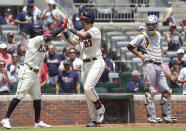 Atlanta Braves Austin Riley, center, celebrates with teammate Ozzie Albies,left, after two-run home run as Pittsburgh Pirates catcher Jacob Stallings watches in the third inning of a baseball game Sunday, May 23, 2021 in Atlanta. (AP Photo/Tami Chappel)