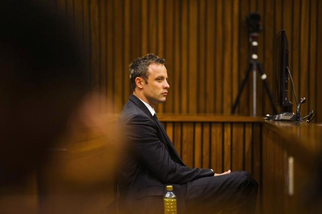 Olympic and Paralympic track star Oscar Pistorius sits in the dock during court proceedings at the North Gauteng High Court in Pretoria, March 13, 2014. Pistorius is on trial for murdering his girlfriend Reeva Steenkamp at his suburban Pretoria home on Valentine's Day last year. REUTERS/Alet Pretorius/Media24/Pool (SOUTH AFRICA - Tags: SPORT CRIME LAW ATHLETICS)
