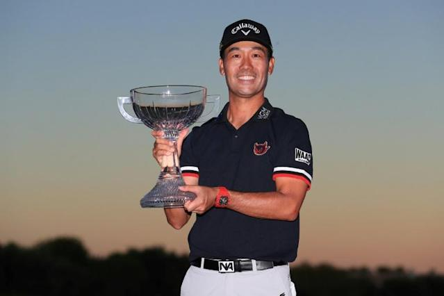 Korean-born American Kevin Na celebrates with the trophy after winning the US PGA Tour's Shriners Hospitals for Children Open at the second playoff hole in Las Vegas (AFP Photo/TOM PENNINGTON)