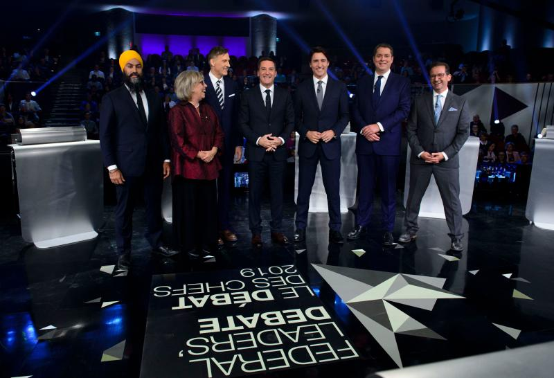 (FromL) Federal party leaders, NDP leader Jagmeet Singh, Green Party leader Elizabeth May, People's Party of Canada leader Maxime Bernier, host Patrice Roy from Radio, Canada's Prime Minister and Liberal leader Justin Trudeau, Conservative leader Andrew Scheer, and Bloc Quebecois leader Yves-Francois Blanchet pose for pictures before the Federal leaders French language debate at the Canadian Museum of History in Gatineau, Quebec on October 10, 2019. (Photo by Sean Kilpatrick / POOL / AFP) (Photo by SEAN KILPATRICK/POOL/AFP via Getty Images)