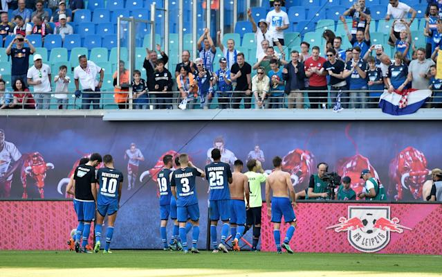 Soccer Football - Bundesliga - RB Leipzig vs TSG 1899 Hoffenheim - Red Bull Arena, Leipzig, Germany - April 21, 2018 Hoffenheim's Pavel Kaderabek and team mates celebrate in front of the fans at the end of the match REUTERS/Matthias Rietschel DFL RULES TO LIMIT THE ONLINE USAGE DURING MATCH TIME TO 15 PICTURES PER GAME. IMAGE SEQUENCES TO SIMULATE VIDEO IS NOT ALLOWED AT ANY TIME. FOR FURTHER QUERIES PLEASE CONTACT DFL DIRECTLY AT + 49 69 650050