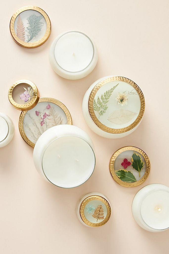 "<p><strong>Rosy Rings</strong></p><p>anthropologie.com</p><p><strong>$15.00</strong></p><p><a href=""https://go.redirectingat.com?id=74968X1596630&url=https%3A%2F%2Fwww.anthropologie.com%2Fshop%2Fholiday-floral-press-candle&sref=https%3A%2F%2Fwww.countryliving.com%2Fshopping%2Fgifts%2Fnews%2Fg4835%2Fbirthday-gifts-for-mom%2F"" rel=""nofollow noopener"" target=""_blank"" data-ylk=""slk:Shop Now"" class=""link rapid-noclick-resp"">Shop Now</a></p><p>These candles are just as pretty when they're not lit, thanks to lovely lids bedecked in pressed botanicals. </p>"