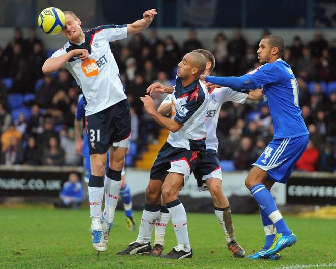 "Bolton Wanderers' English defender David Wheater (L) clears the ball during the FA Cup football match between Macclesfield Town and Bolton Wanderers at Moss Rose,Macclesfield, north-west England, on January 7 2012. (Photo by Andrew Yates. Restricted To Editorial Use. No Use With Unauthorized Audio, Video, Data, Fixture Lists, Club/league Logos Or ""live"" Services. Online In-match Use Limited To 45 Images, No Video Emulation. No Use In Betting, Games Or Single Club/league/player Publications. /AFP/Getty Images)"